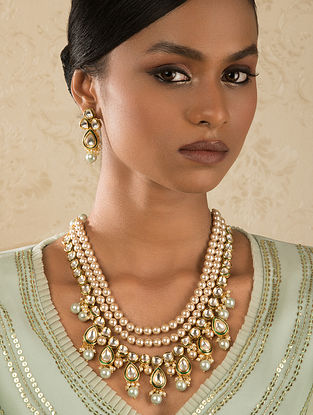 Cream Gold Tone Kundan Necklace And Earrings With Pearls