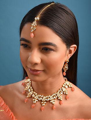 Peach Gold Tone Kundan Necklace And Earrings With Maangtikka