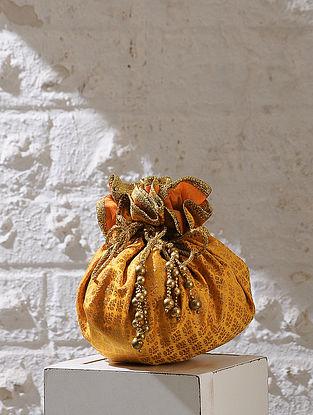 Yellow Handcrafted Brocade And Silk Potli With Latkans