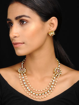 Ivory Gold Tone Kundan Inspired Layered Necklace With A Pair Of Earrings(Set of 2)