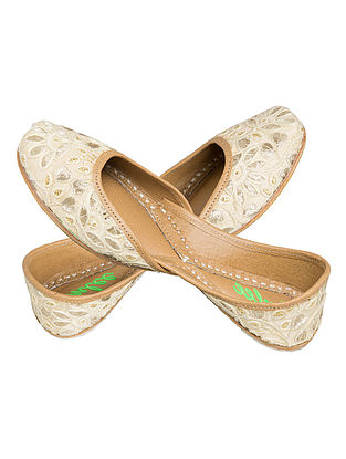 Ivory Thread Embroidered Silk and Leather Juttis for Women
