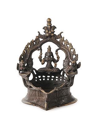 Brass Diya with Deity design (L:5.2in, W:4.5in, H:6.5in)
