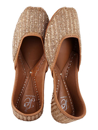 Gold Handcrafted Juttis with Cut Dana Work