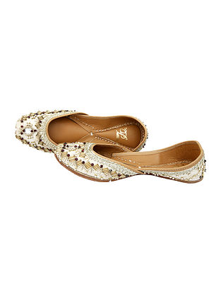 White Handcrafted Silk and Leather Juttis With Metal Embellishments