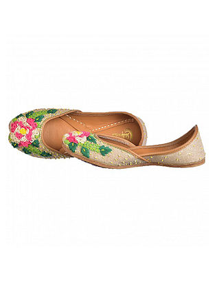 Beige Hand-Embroidered Leather Juttis with Beads and Thread Embellishments
