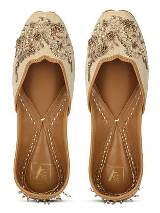 Beige Gold Embellished Dupion Silk and Leather Juttis with Zardosi Work