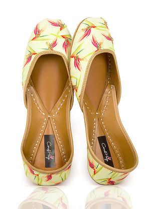 Yellow Floral Printed Canvas and Leather Juttis with Embellishments