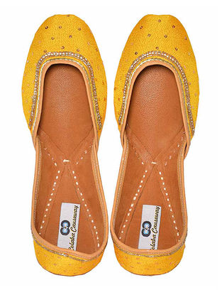 Yellow Thread Embroidered Silk and Leather Juttis with Embellishments