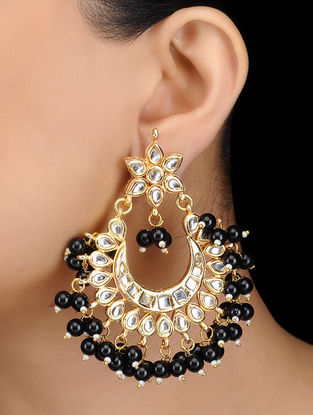Black Kundan-inspired Gold Tone Earrings with Floral Motif