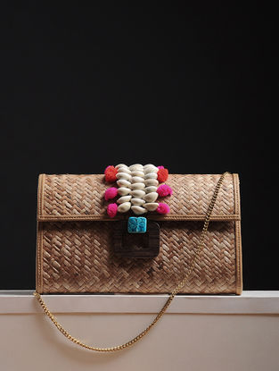 Gold Handcrafted Cane Sling Bag With Shell Embellishments And Pom-Pom