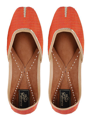Orange Hand-embroidered Silk Leather Juttis with Tilla Work