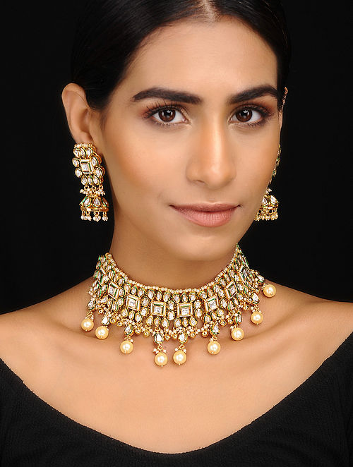 Gold Tone Kundan Inspired Pearl Beaded Necklace With A Pair Of Earrings(Set of 2)