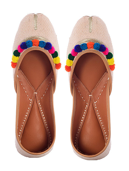 Off-White Handwoven Leather Juttis with Pom-poms