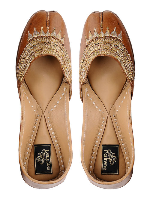 Tan Hand-embroidered Leather Juttis with Tilla Work