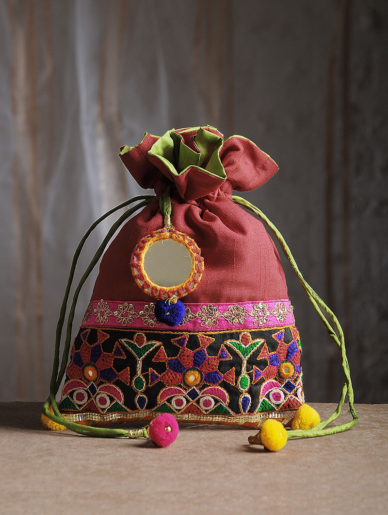 Maroon Hand-Embroidered Chroma Silk Potli with Mirror Embellishments and Tassels